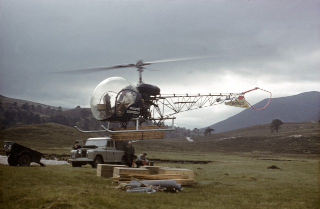 Helicopter ferring bridge materials in the Cairngorms in 1959
