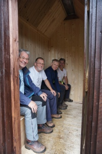 MBA volunteers sitting on the new toilet seats at Corrour Bothy, Glen Dee